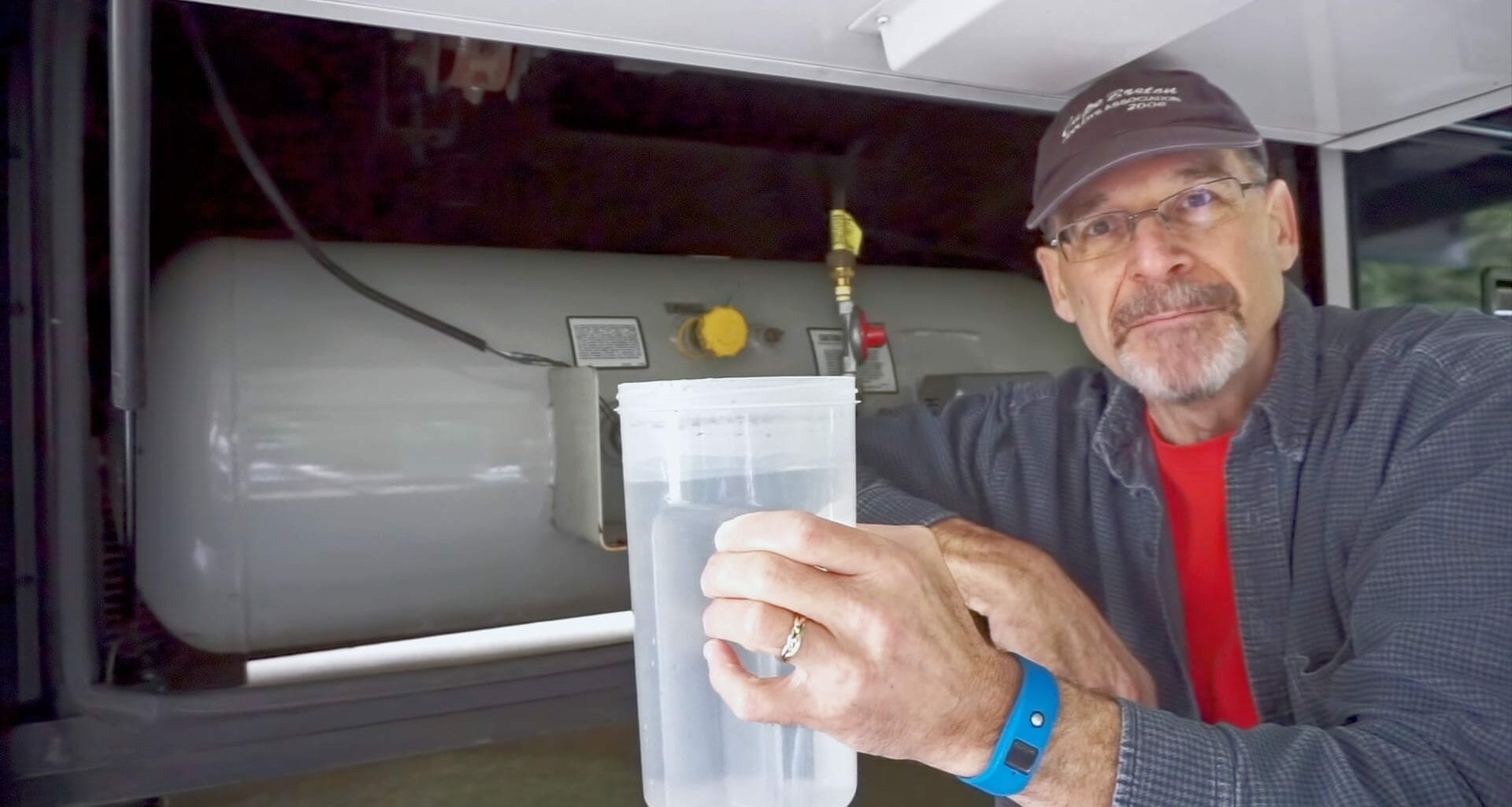 Peter ready to check the propane level in our RVs propane tank