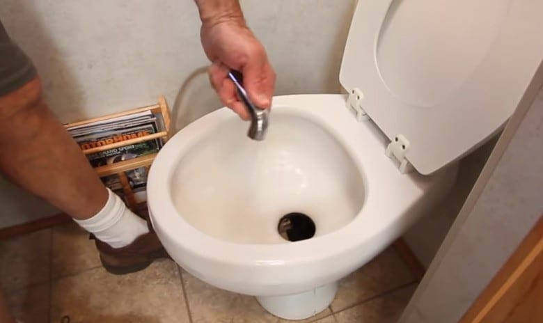 Use gentle alternatives like a sprayer when cleaning RV toilets