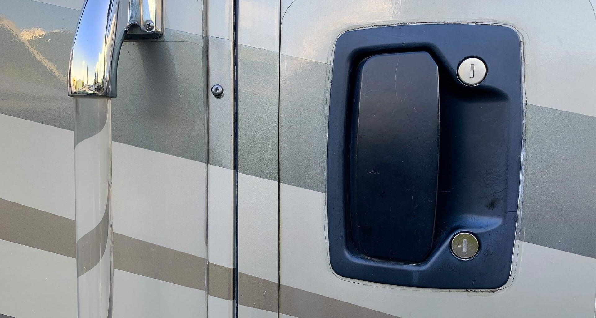An RV door latch handle from the outside