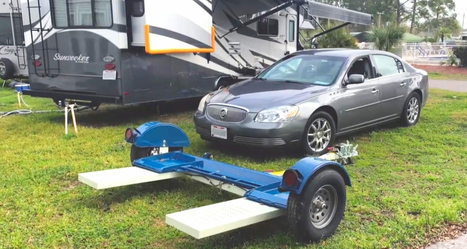 RV Tow Dolly, Front-Wheel-Drive Tow Car, and RV parked in RV Site